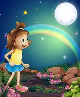 Een kind dat verbaasd is door de aanblik van de regenboog en de volle maan