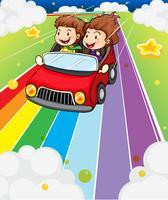 Twee kinderen rijden in een rode auto