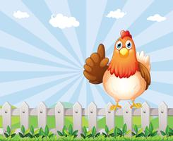 Een dikke kip boven het hek vector