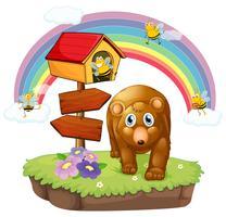 Een bruine beer dichtbij de pethouse en de pijlraad