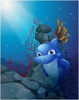 Een glimlachende haai dichtbij de rotsen vector