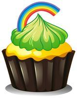 Een cupcake met een groene kers