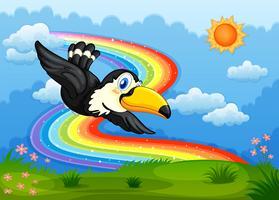 Een vogel in de lucht met een regenboog