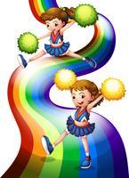 Een regenboog en de twee cheerers vector