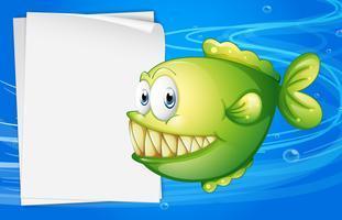 Een groene piranha naast een leeg bord