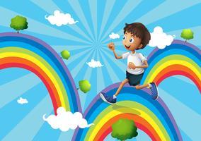 Een jongen die boven de regenboog loopt vector