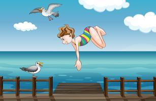 Een jong meisje dat duikt
