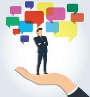 grote hand houden Succesvolle zakenman staande gekruiste armen met chat box achtergrond vector