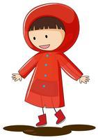 Een doodle jongen draagt regenjas vector