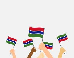Vectorillustratieg handen die de vlaggen van Gambia houden die op grijze achtergrond worden geïsoleerd