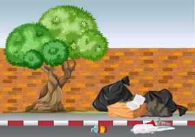 Scène met afval onder de boom vector