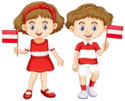 Jongen en meisje met de vlag van Oostenrijk vector