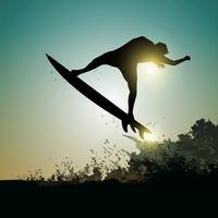 surfer bij zonsondergang vector