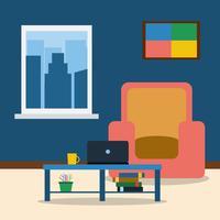 Interieur van de kamer met fauteuil, foto, laptop en salontafel