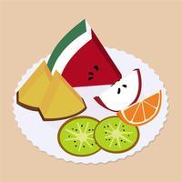 Fruit op een plaat wordt geplaatst die. Ananas, kiwi, sinaasappel, watermeloen en appel.