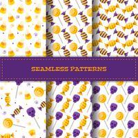 Set van naadloze patronen met cartoon snoepjes.