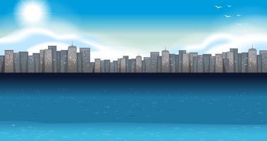 Oceaanscène met gebouwen op achtergrond