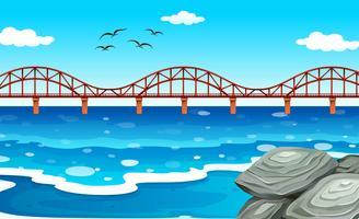 Uitzicht op de oceaan met de brug vector