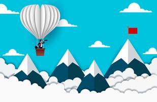 Zakenman die zich op Ballon bevindt die aan doel kijkt vector