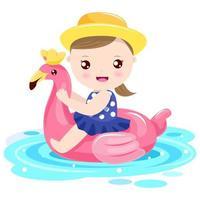 Het spelen van het meisje met flamingo zwemt ring