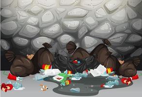 Stapel vuilniszakken op de grond voor muur