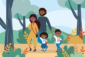 Moeder en vader met hun jongen en meisje studenten