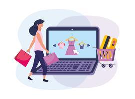 Vrouw online winkelen met laptop en e-commerce elementen vector