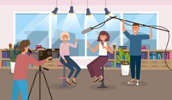 Vrouwelijke verslaggevers in de studio