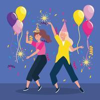 Vrouwen dansen met feestmutsen en ballonnen