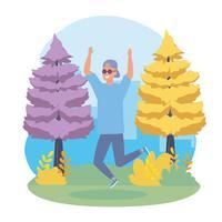 Jonge man met zonnebril springen in park