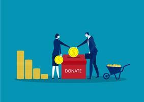 twee zakenmensen gooien gouden munten in een doos voor donaties