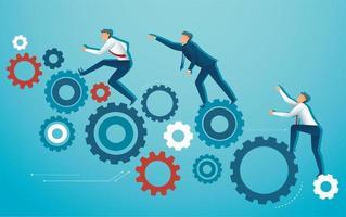 zakenmensen klimmen tandwielen