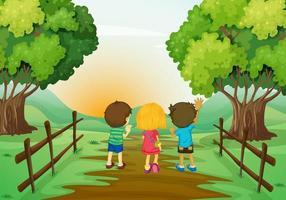 Drie kinderen kijken naar de zonsondergang