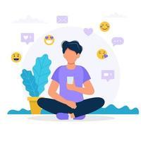 Man met een smartphone, sociale media pictogrammen in vlakke stijl