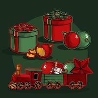 Kerstset. Geschenkdozen, kerstballen en een speelgoedtrein met een notenkraker