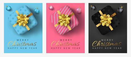 Prettige kerstdagen en gelukkig Nieuwjaar belettering, realistische geschenkdozen, kerstballen vector