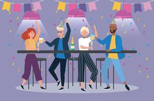 vrouwen en mannen met feestbanner en bier