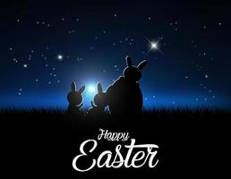 silhouetten van konijnen tegen een maanlichthemel