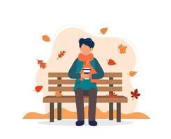 man met koffie op bankje in de herfst