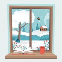 raam met uitzicht op de winter, boek en een kopje koffie