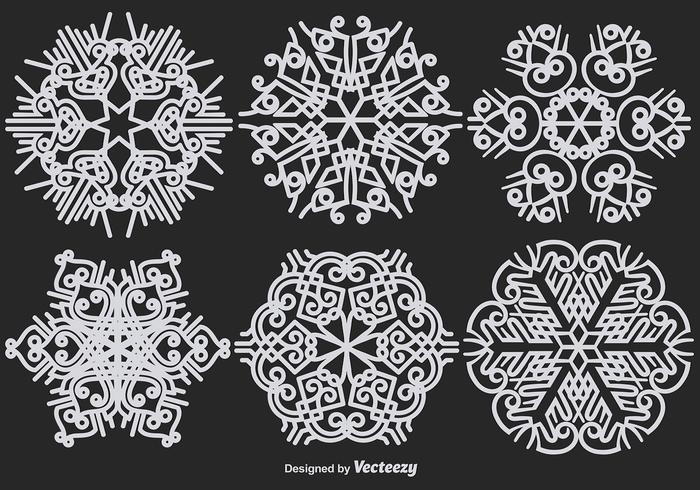 Abstrakte ornamentale weiße Schneeflocken Vektor-Set vektor