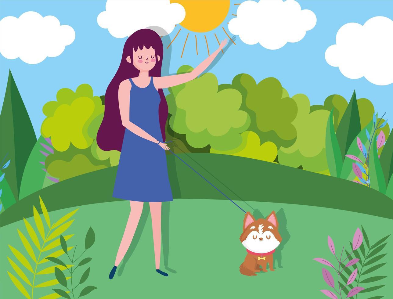 ung kvinna som går sin hund i parken vektor