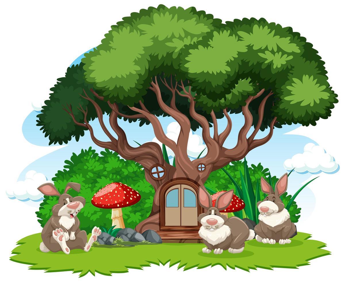 Baumhaus mit drei Kaninchen vektor