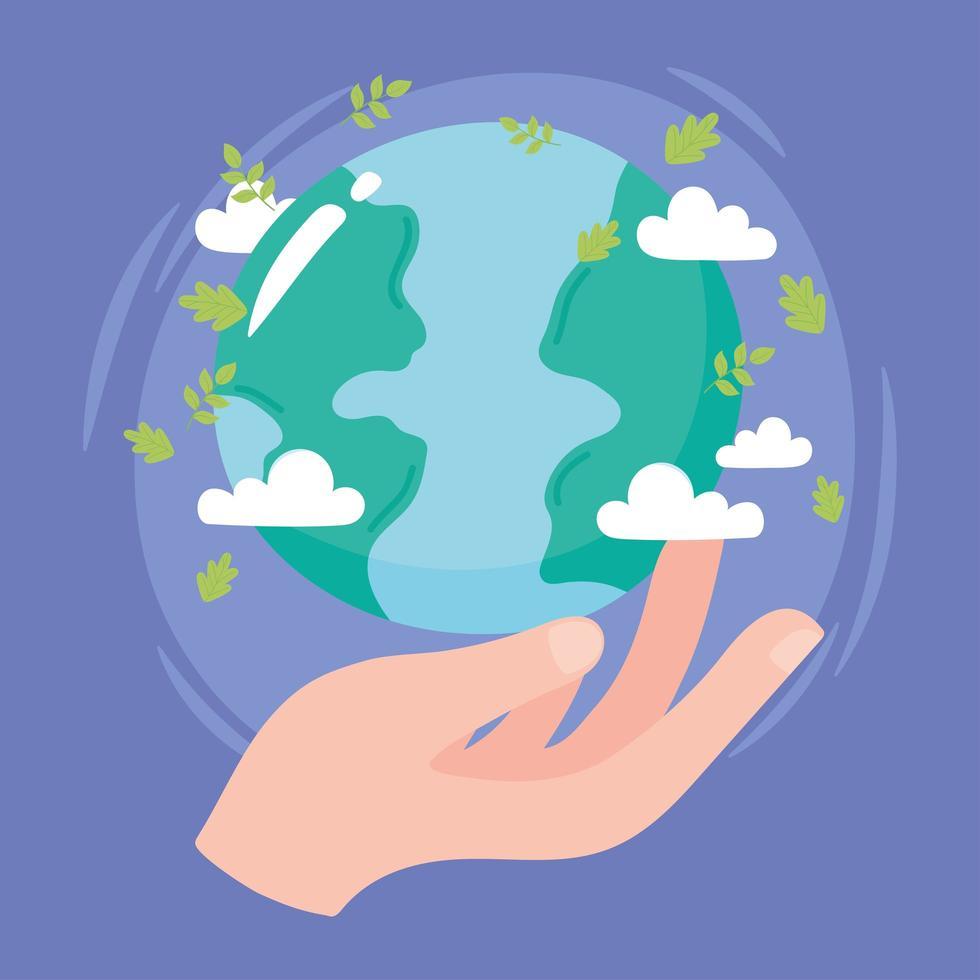 hand som håller världen med löv och moln vektor