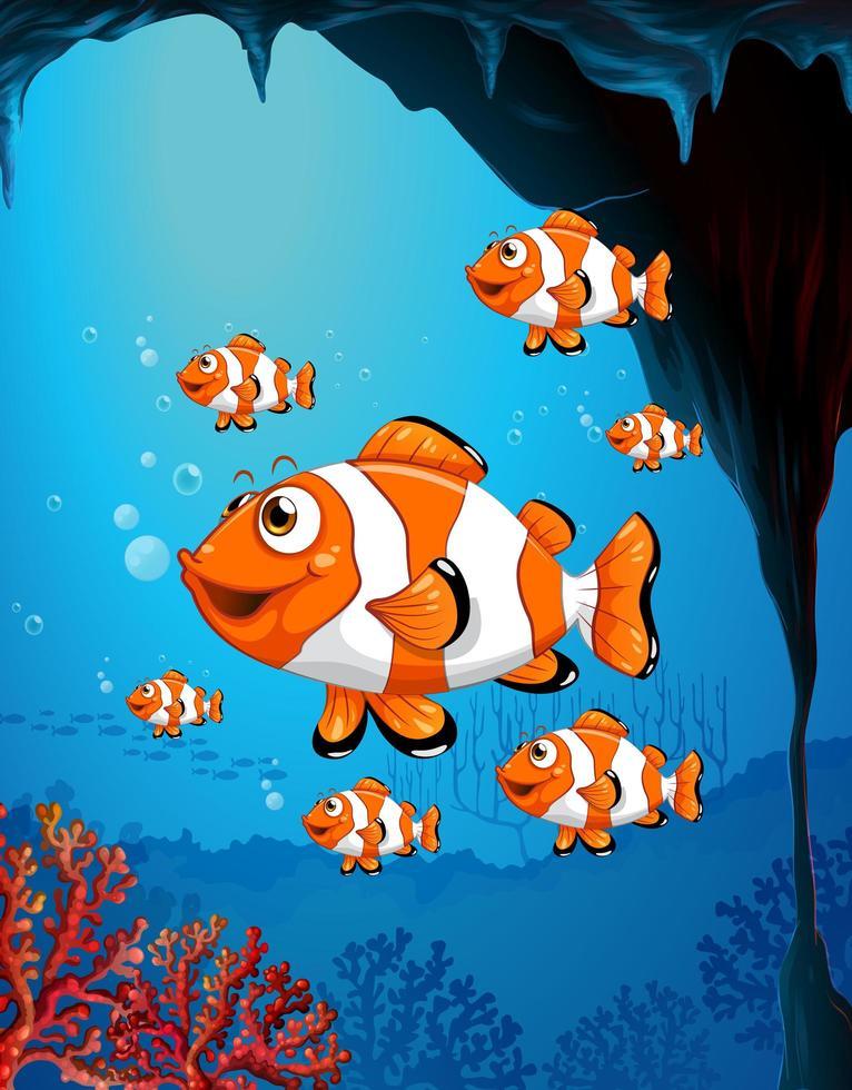 många exotiska fiskar seriefigur i undervattensscenen med koraller vektor