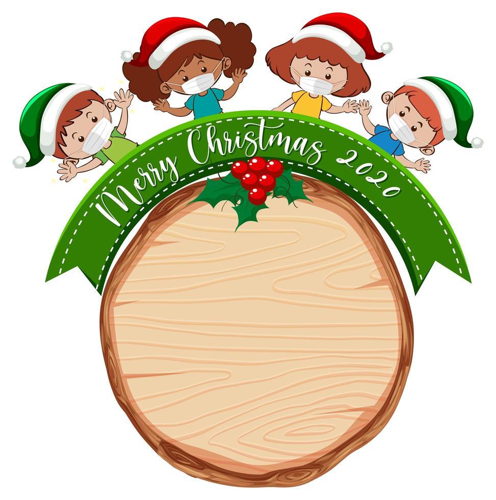 tom träskiva med god jul 2020 teckensnittslogotyp och barn bär mask vektor