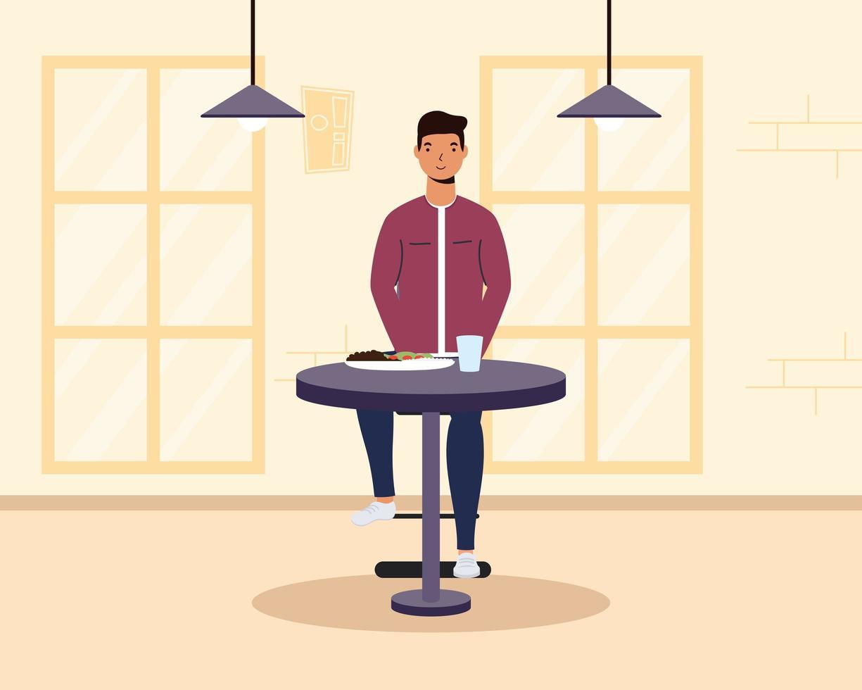ung man sitter i en restaurang vektor