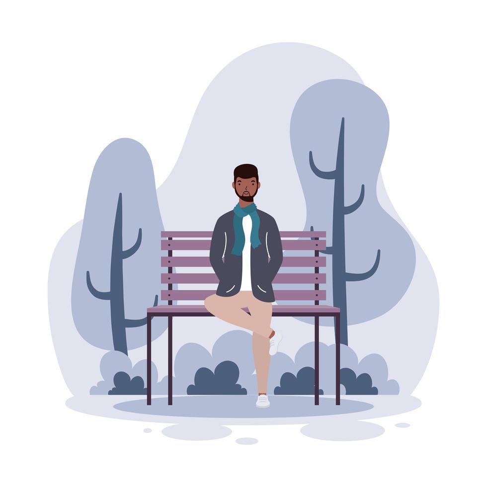 junger Mann sitzt auf dem Parkstuhl vektor