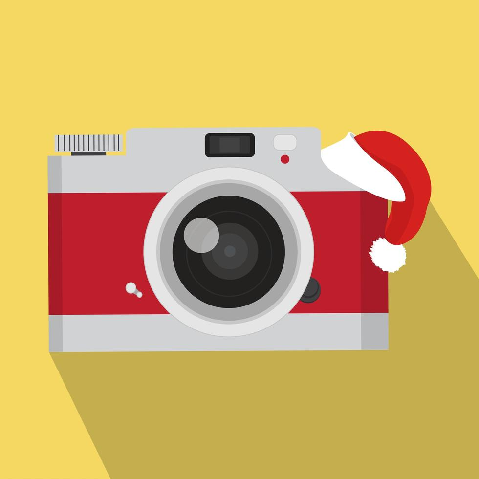 röd vintage kamera med santa hatt vektor