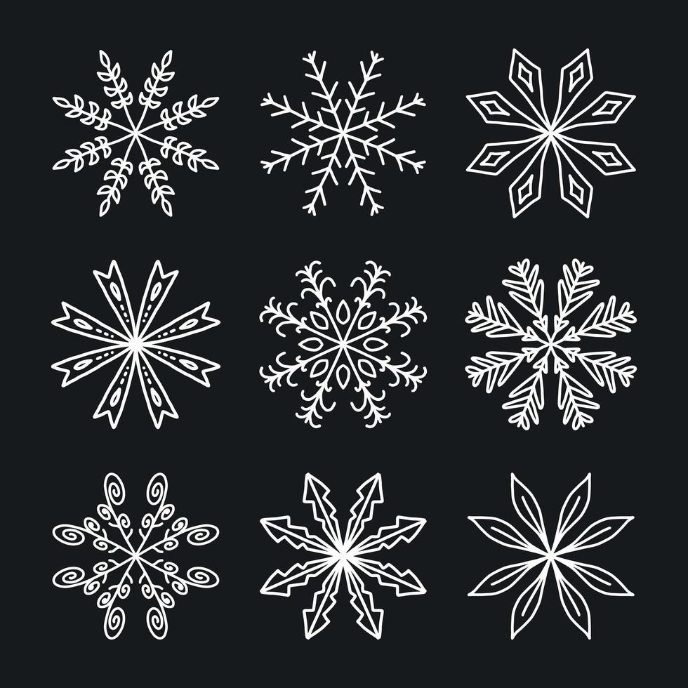 uppsättning av vita vintersnöflingor vektor